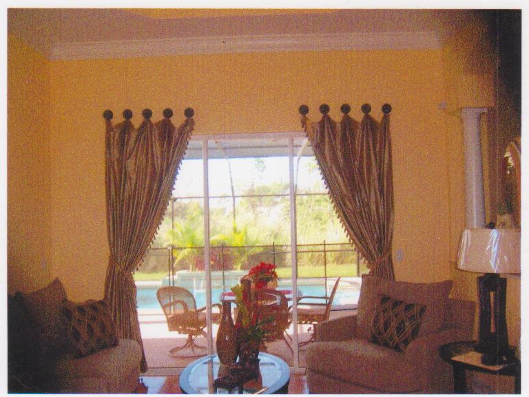 Custom Drapes hanging from decorative medallions