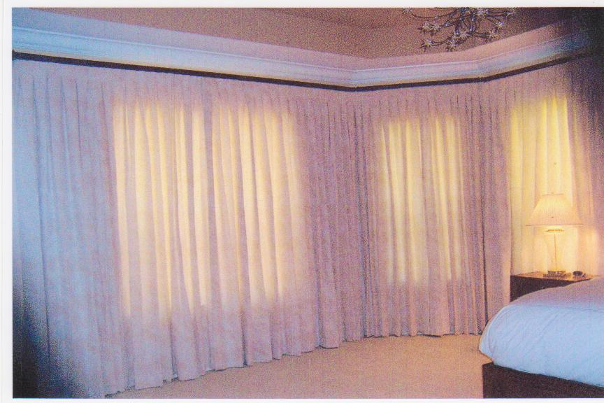 Custom Drapes -  inverted pinch pleat drapes on a decorative traverse rod